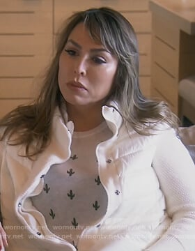 Kelly's white puffer jacket and cactus print sweater on The Real Housewives of Orange County