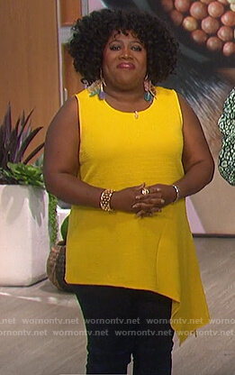 Sheryl's yellow asymmetric top on The Talk