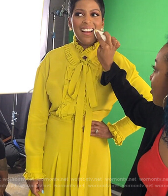 Tamron's yellow ruffled blouse and skirt on Tamron Hall Show
