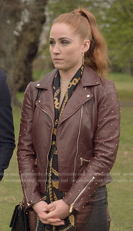 Zara's burgundy leather jacket with studded sleeves on Four Weddings and a Funeral