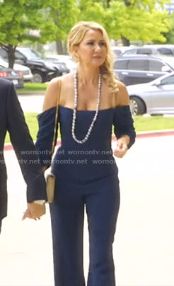 Kary's navy off-shoulder jumpsuit on The Real Housewives of Dallas