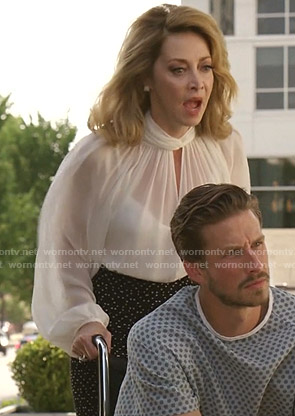 Laura Van Kirk's white keyhole blouse and dotted skirt on Dynasty