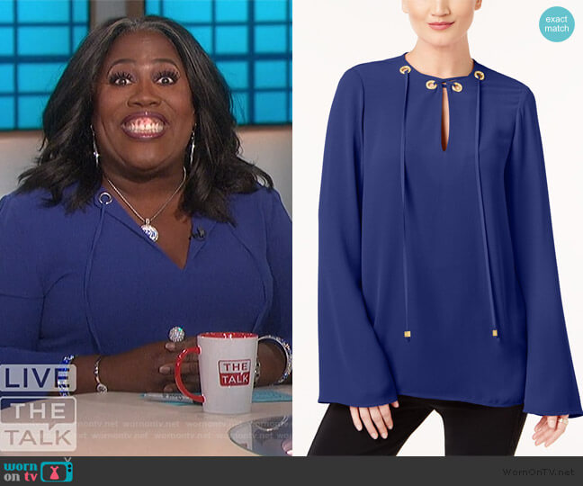 Embellished Grommet Tie-Neck Top by MICHAEL Michael Kors worn by Sheryl Underwood  on The Talk