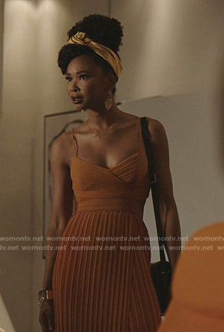 Monica's orange pleated dress on Dynasty