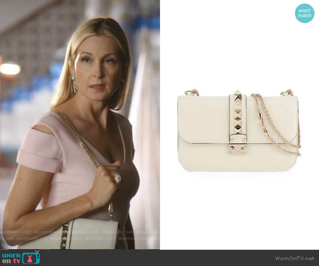 Rockstud Flap Shoulder Bag by Valentino worn by Melissa Daniels (Kelly Rutherford) on Dynasty