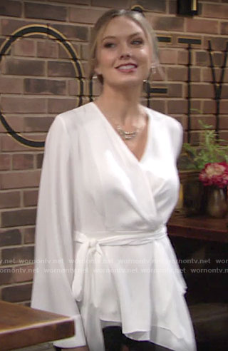 Abby's white bell-sleeve wrap blouse on The Young and the Restless