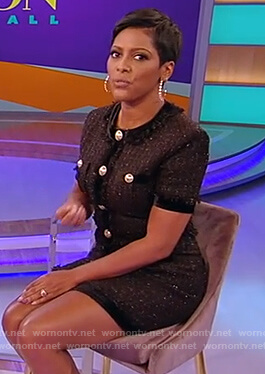 Tamron's black tweed mini dress with buttons on Tamron Hall Show