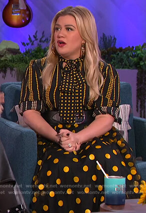Kelly's black and yellow star print blouse and skirt on The Kelly Clarkson Show