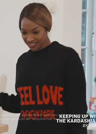 Malika's black I Feel Live Sweater on Keeping Up with the Kardashians