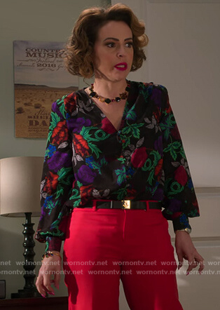 Coralee's black floral blouse on Insatiable