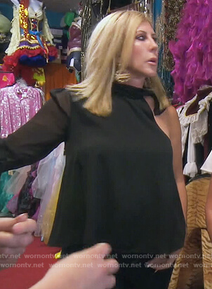 Vicki's black one sleeve top on The Real Housewives of Orange County