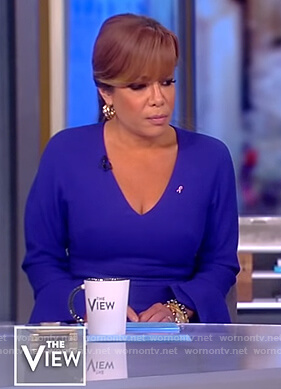 Sunny's purple v-neck dress with ruffle cuffs on The View