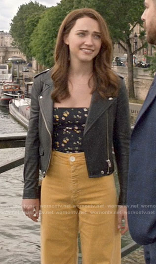 Cara's black floral tie strap top  with yellow jeans and leather jacket on God Friended Me