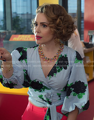 Coralee's blue gingham check floral wrap top on Insatiable