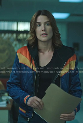 Dex's blue and yellow bomber jacket on Stumptown