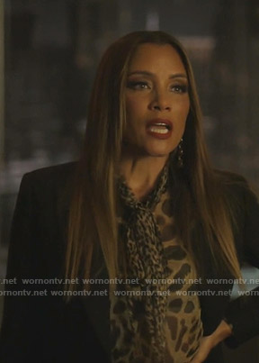 Dominique's leopard print tie neck blouse on Dynasty