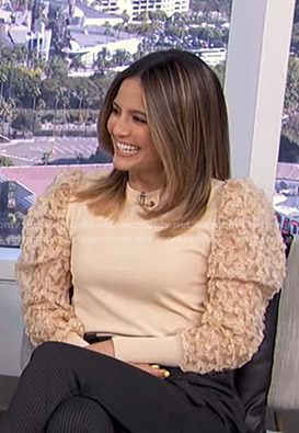 Erin's beige tulle sleeve sweater on E! News