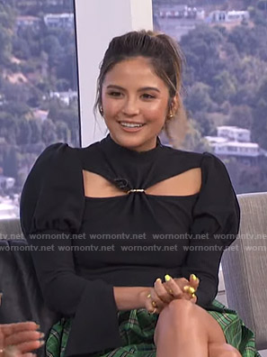 Erin's black cutout top and green plaid mini skirt on E! News