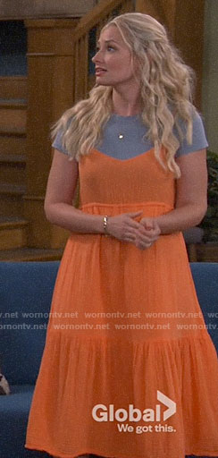 Gemma's orange tiered dress on The Neighborhood