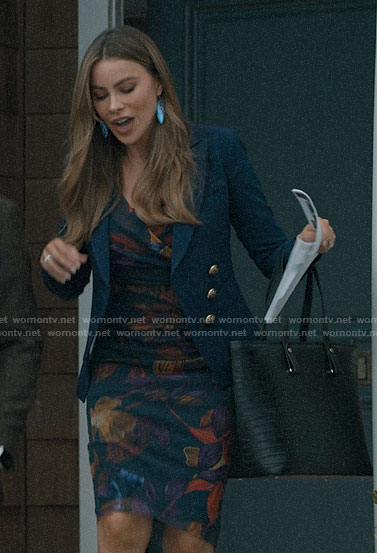 Gloria's leaf print dress and blue blazer on Modern Family