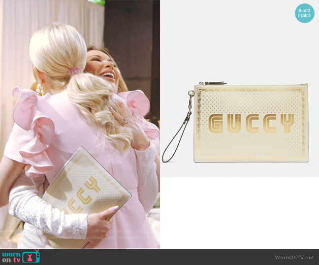 Star Print Guccy Clutch Bag by Gucci worn by LeeAnne Locken  on The Real Housewives of Dallas