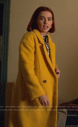 Infinity's long yellow coat on The Politician