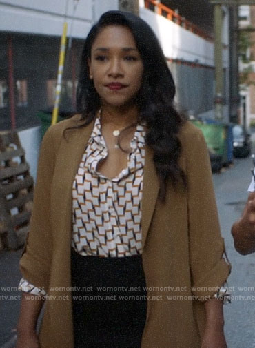 Iris's camel jacket on The Flash