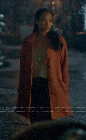 Iris's geometric print top and orange trench coat on The Flash