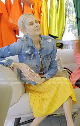 Kameron's distressed denim jacket and yellow midi skirt on The Real Housewives of Dallas