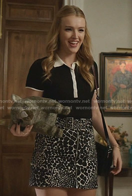 Kirby's black polo top and animal print mini skirt on Dynasty