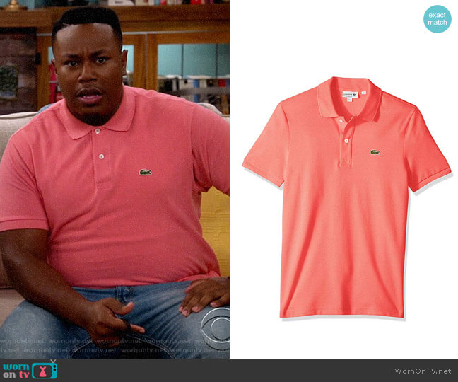 Lacoste Classic Polo Shirt in Amaryllis Pink worn by Marty (Marcel Spears) on The Neighborhood
