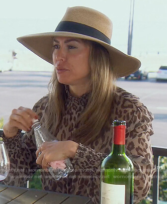 Kelly's leopard tie neck blouse on The Real Housewives of Orange County