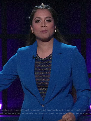 Lilly Singh's blue suit and metallic striped top on A Little Late with Lilly Singh