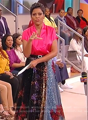 Tamron's pink satin top and metallic skirt on Tamron Hall Show