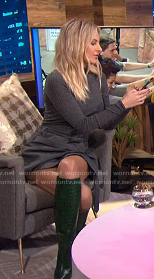 Morgan's grey ribbed sweater and green boots on E! News Nightly Pop