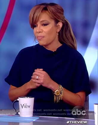 Sunny's navy short sleeve jumpsuit on The View