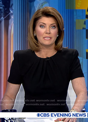 Norah's black pleated neck sheath dress on CBS Evening News