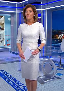 Norah's white tweed dress on CBS Evening News