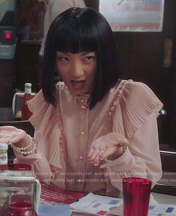 Mei's pink ruffled blouse on Sunnyside