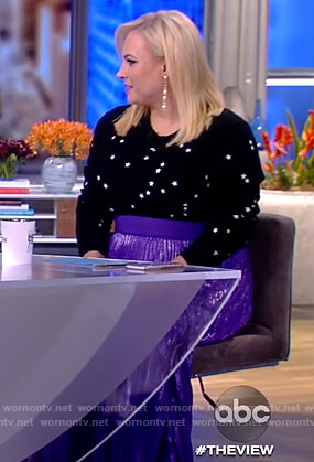Meghan's black star sweater and purple skirt on The View