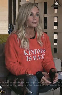 Tamra's red Kindness is Magic sweater on The Real Housewives of Orange County
