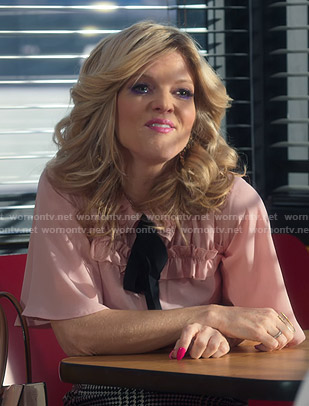 Regina's pink ruffled tie neck blouse on Insatiable