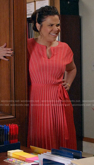 Sara's coral pleated dress on All Rise