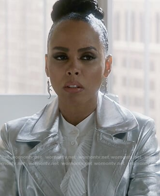 Teagan's ruffle blouse and silver metallic coat on How to Get Away with Murder