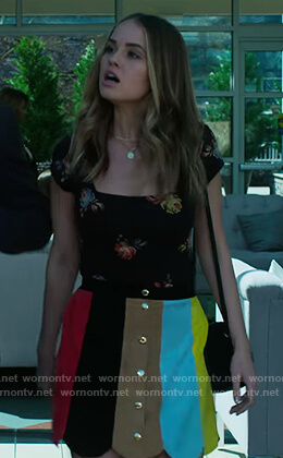 Patty's black floral top and stripe skirt on Insatiable
