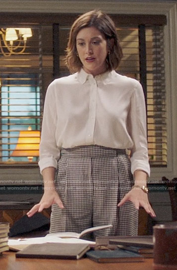 Sydney's checked trousers and white blouse on Bluff City Law