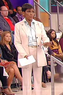 Tamron's white blazer and tie neck silk blouse on Tamron Hall Show