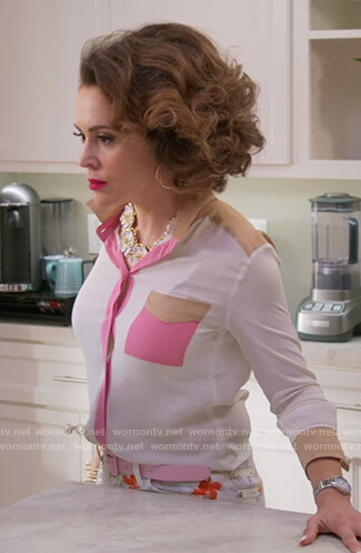 Coralee's white colorblock shirt on Insatiable
