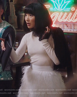 Mei's lace trim sweater and feather skirt on Sunnyside