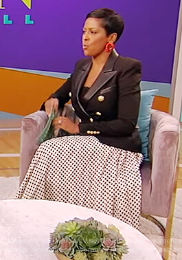 Tamron's black blazer and polka dot skirt on Tamron Hall Show